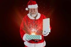 Составное изображение подарочной коробки отверстия Санта Клауса Стоковые Фото
