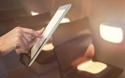 Составное изображение подрезанного изображения рук бизнесмена используя планшет Стоковые Фото