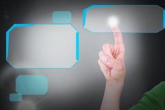 Составное изображение подрезанного изображения человека касаясь незримому экрану Стоковое Изображение