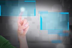 Составное изображение подрезанного изображения человека касаясь незримому экрану Стоковая Фотография RF