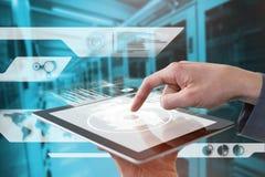 Составное изображение подрезанных рук бизнесмена используя цифровую таблетку Стоковые Фотографии RF