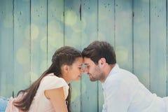 Составное изображение привлекательных молодых пар усмехаясь на одине другого Стоковое фото RF