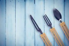 Составное изображение пластичных ножа, вилки и ложки Стоковая Фотография