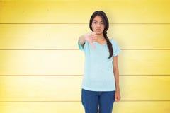 Составное изображение разочарованного брюнет давая большие пальцы руки вниз Стоковое фото RF