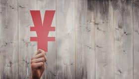 Составное изображение руки держа знак иен Стоковое Изображение RF