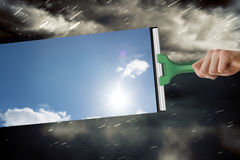 Составное изображение руки используя счищатель Стоковое Фото
