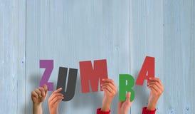 Составное изображение рук задерживая zumba Стоковые Фотографии RF