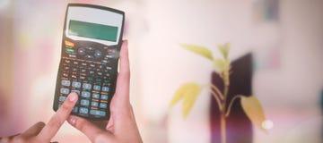 Составное изображение рук коммерсантки используя калькулятор Стоковые Фотографии RF