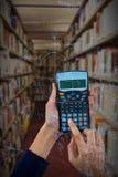 Составное изображение рук коммерсантки используя калькулятор Стоковое Изображение RF