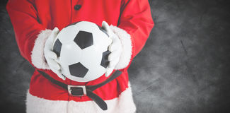 Составное изображение Санта Клауса держа футбол Стоковая Фотография RF