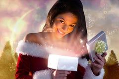 Составное изображение сексуального подарка отверстия девушки santa Стоковые Фотографии RF