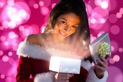 Составное изображение сексуального подарка отверстия девушки santa Стоковое Изображение RF