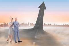 Составное изображение серьезного бизнесмена стоя спина к спине с женщиной Стоковое Изображение