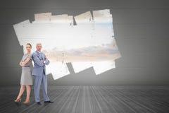 Составное изображение серьезного бизнесмена стоя спина к спине с женщиной Стоковые Фото