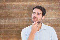 Составное изображение серьезного думая человека смотря вверх Стоковая Фотография RF