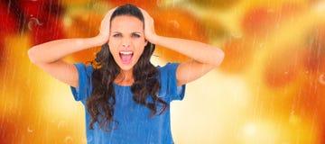 Составное изображение сердитого брюнет крича на камере Стоковые Изображения RF
