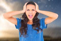 Составное изображение сердитого брюнет крича на камере Стоковая Фотография RF