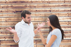 Составное изображение сердитого брюнет обвиняя ее парня Стоковое Изображение RF