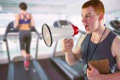 Составное изображение сердитого личного тренера выкрикивая через мегафон Стоковая Фотография RF