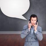 Составное изображение сердитого путать бизнесмена вверх в проводах телефона Стоковая Фотография RF