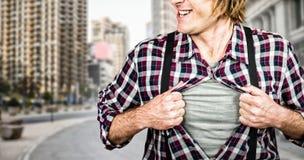 Составное изображение смешного белокурого битника принимая его рубашку стоковая фотография rf