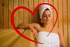 Составное изображение спокойной женщины ослабляя в сауне Стоковое фото RF