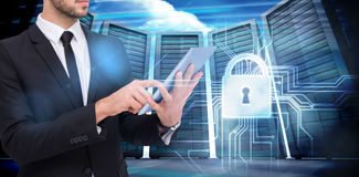 Составное изображение среднего раздела бизнесмена используя цифровой ПК таблетки Стоковые Фото
