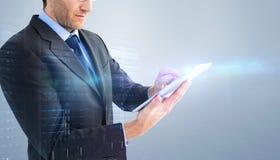 Составное изображение среднего раздела бизнесмена используя цифровую таблетку Стоковое Фото