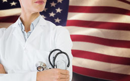 Составное изображение среднего раздела женского доктора с стетоскопом в больнице Стоковая Фотография RF