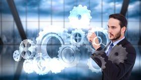 Составное изображение сфокусированного бизнесмена указывая в куртку костюма Стоковые Изображения