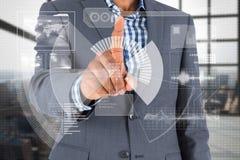 Составное изображение сфокусированного бизнесмена указывая на интерфейс Стоковые Изображения RF