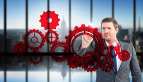 Составное изображение сфокусированного бизнесмена указывая с пальцем Стоковая Фотография