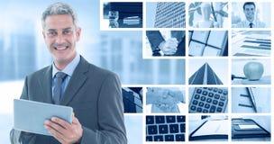 Составное изображение счастливого бизнесмена используя ПК таблетки Стоковая Фотография RF