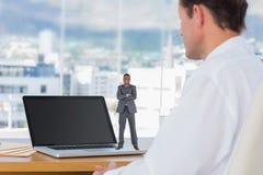 Составное изображение счастливого бизнесмена смотря камеру Стоковое Изображение