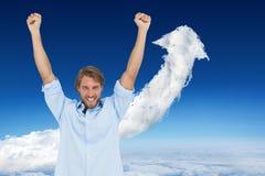 Составное изображение счастливого человека празднуя успех с оружиями вверх Стоковое Изображение RF