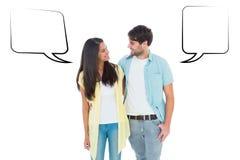 Составное изображение счастливых вскользь пар усмехаясь на одине другого Стоковое фото RF
