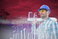 Составное изображение усмехаясь архитектора смотря отсутствующий пока держащ светокопию Стоковые Изображения