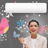 Составное изображение усмехаясь коммерсантки держа ручку с пузырем речи Стоковое Изображение