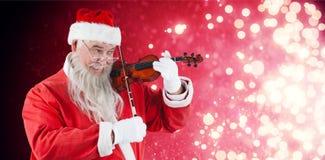 Составное изображение усмехаясь Санта Клауса играя скрипку Стоковые Фотографии RF