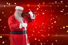 Составное изображение усмехаясь Санта Клауса играя скрипку Стоковое фото RF