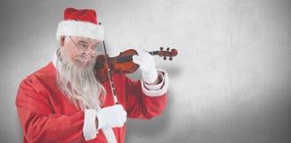 Составное изображение усмехаясь Санта Клауса играя скрипку Стоковое Изображение