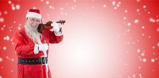 Составное изображение усмехаясь Санта Клауса играя скрипку Стоковое Изображение RF