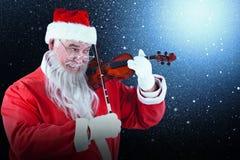 Составное изображение усмехаясь Санта Клауса играя скрипку Стоковые Изображения RF