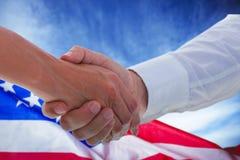 Составное изображение человека и женщины делая официально рукопожатие Стоковое Изображение RF