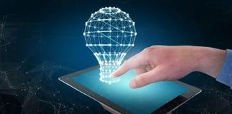 Составное изображение croped рук бизнесмена используя цифровую таблетку Стоковая Фотография