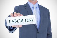 Составное изображение midsection бизнесмена держа пустую карточку Стоковая Фотография RF