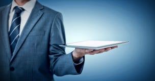 Составное изображение midsection бизнесмена держа планшет Стоковые Фотографии RF