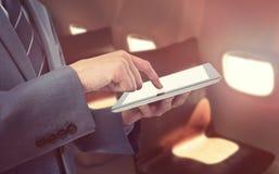 Составное изображение midsection бизнесмена используя планшет Стоковое фото RF