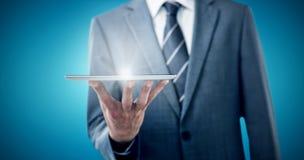 Составное изображение midsection бизнесмена с цифровой таблеткой Стоковые Фотографии RF