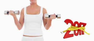 Составное изображение midsection женщины работая с гантелями Стоковое фото RF